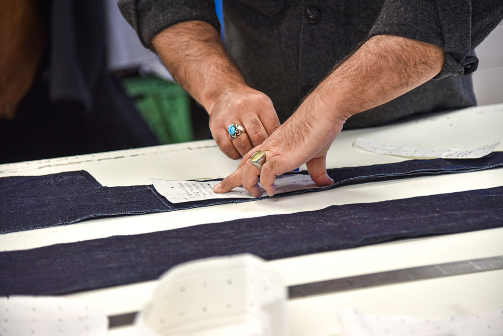 One of Ernesto's tailors working with denim