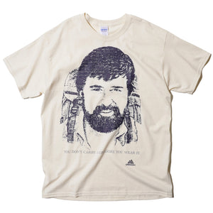 "GREGORY ""YOU DON'T CARRY A GREGORY, YOU WEAR IT."" WAYNE GREGORY PORTRAIT T-SHIRT (CREAM)"
