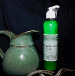 8 oz bottle hand and body lotion made with emu oil from 3 Feathers Emu Ranch
