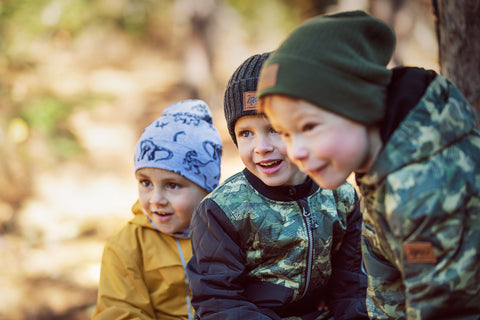 kid boys wearing hats outdoors in spring time