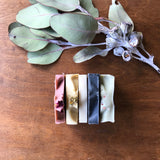 Pack of smaller soaps that are great for travel, gifts. This pack contains three or four smaller bars chosen at random and packaged together in a soft muslin bag. Natural, Vegan and palm oil free and made in Adelaide South Australia