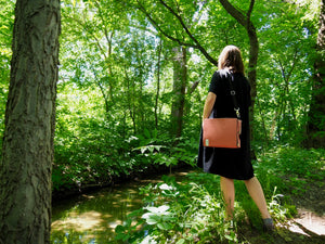 Standing alone in the woods with a well considered bicycle bag
