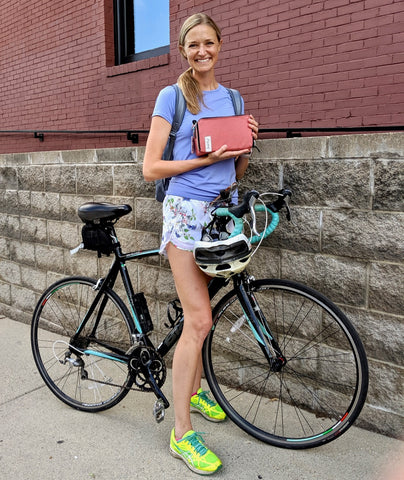 äventyr Customer Jill picking up The Essential Bicycle Handlebar Bag on her bicycle commute home