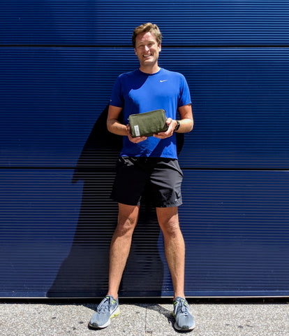 äventyr Customer Mark picking up The Essential Bicycle Handlebar Bag in Cobalt on his lunchtime run at The Guthrie