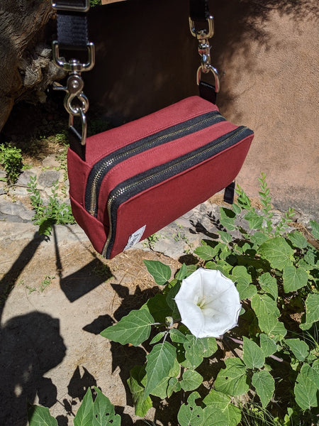 äventyr The Essential Bicycle Handlebar Bag next to Georgia O'Keeffe's Jimson Weed Flower