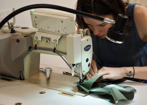 Kathryn, Owner of Winsome Goods, sewing The Social