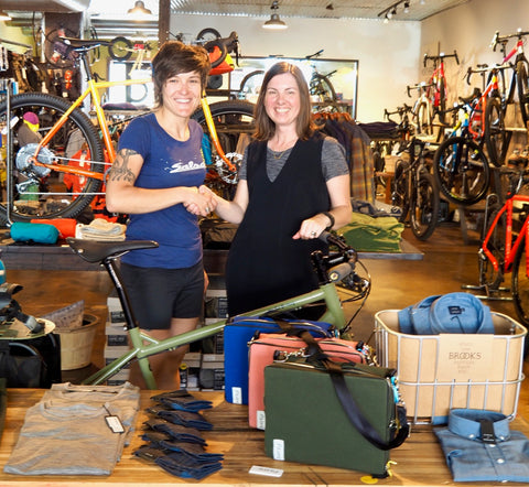 Megan Barr and äventyr owner, DeAnn, at Angry Catfish Bike Shop with The Social in Cobalt, Nautical Red, and Olive