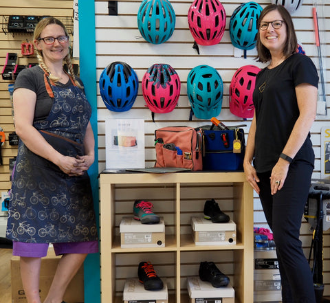 Alicia, owner of Seven Spokes Bike Shop, and DeAnn, owner of äventyr with The Social in Nautical Red and Cobalt