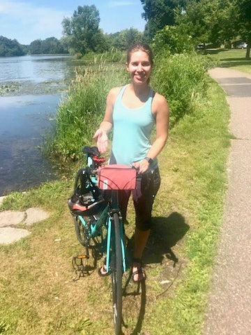 äventyr recipient Hannah with her Birthday Gift:  The Essential Bicycle Handlebar Bag in Nautical Red