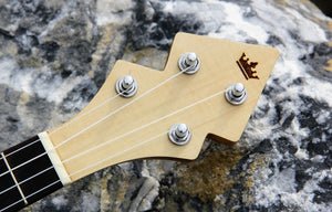 DUKE10 Banjolele Headstock on a rock
