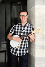 Load image into Gallery viewer, Owner of Duke Banjo Ukuleles, Jamie Houston, with  DUKE10 Banjolele