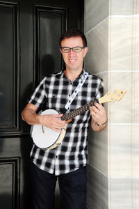 Owner of Duke Banjo Ukuleles, Jamie Houston, with  DUKE10 Banjolele