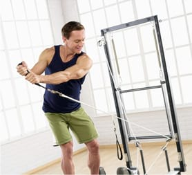 Reformer golf swing exercise