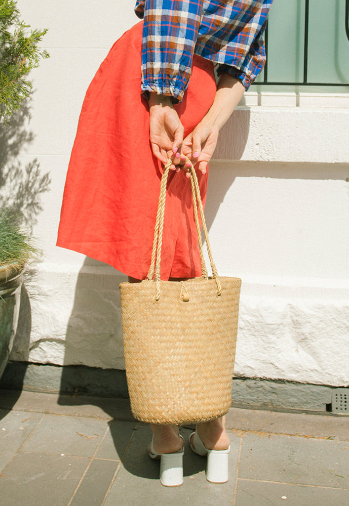handwoven natural straw bucket bag