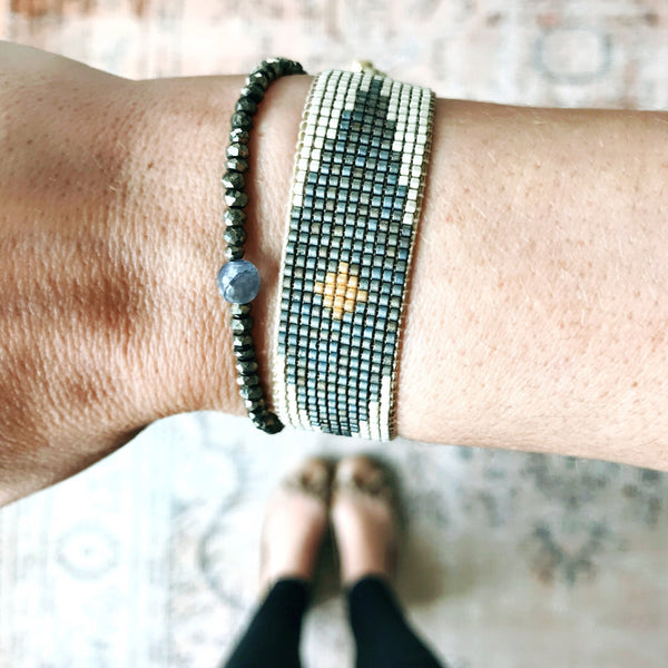 Wearing woman bracelet in colors Mate silver, petrol blue and gold. Arlequin beaded miyuki bracelet for woman by Carmen Salvador