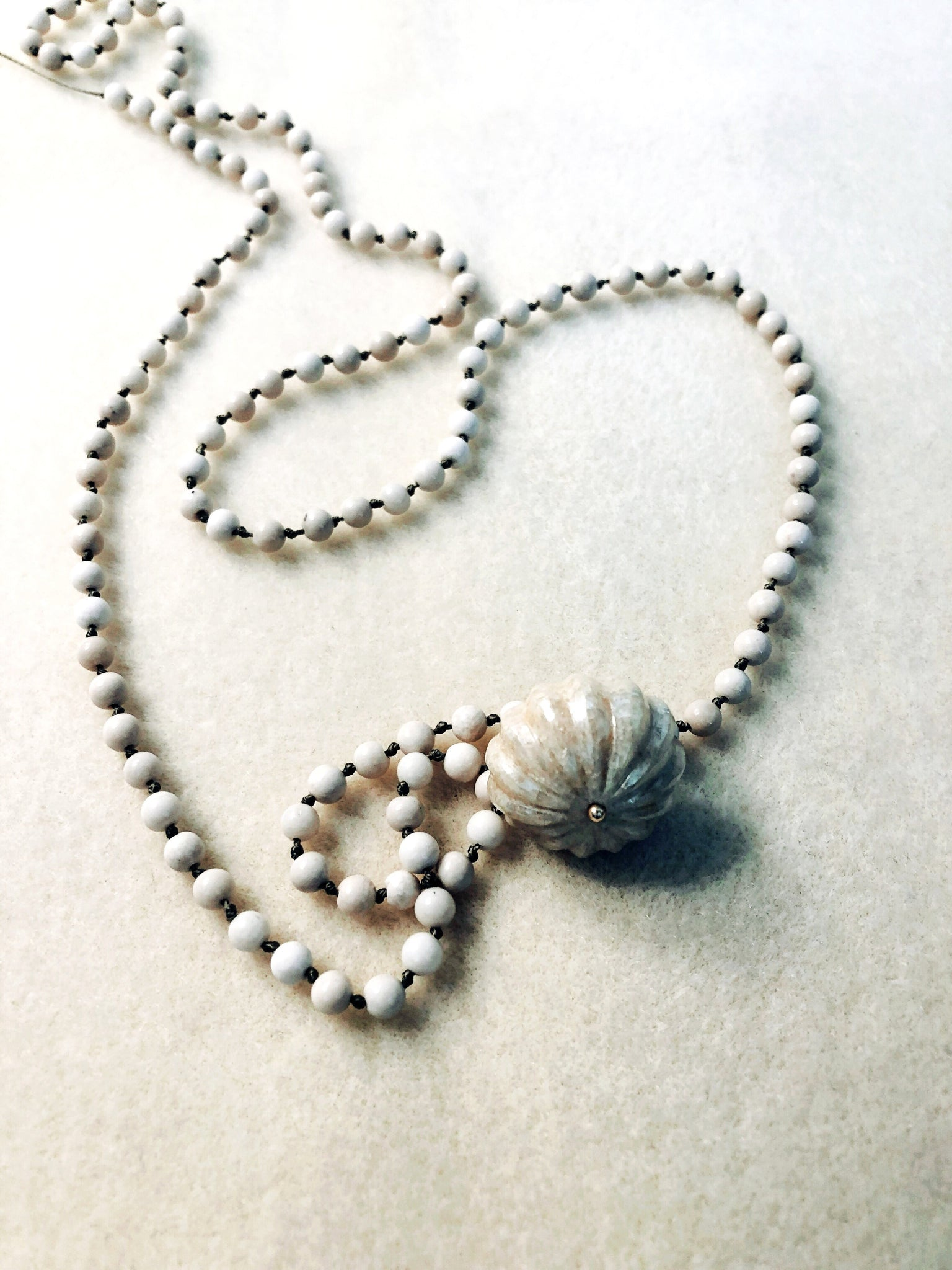 Fossil stone and quartz necklace