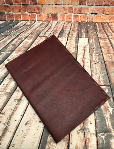 Raw leather notebook cover