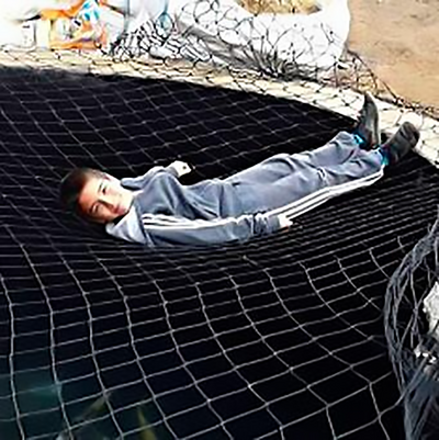 Child safe pond net cover with child safely on top