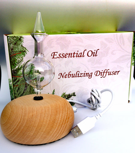 Wood and Glass Diffuser - Professional Aromatherapy diffuser for sale online in Ireland. Handcrafted wooden base and glass body. The most powerful essential diffuser for sale in Ireland. Diffuse essential oils. Best selling essential oil diffuser in Ireland.