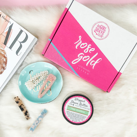 All Girl Shave Club box with shave butter and trending hair clips