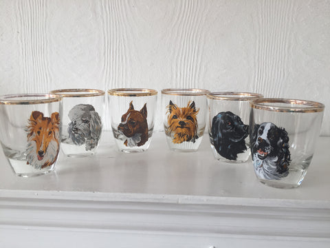 Set of six shot glasses with dog motifs.