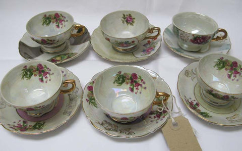Set of six cups and saucers.