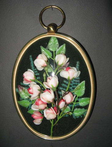 Flower wall-hanging in convex glass frame.