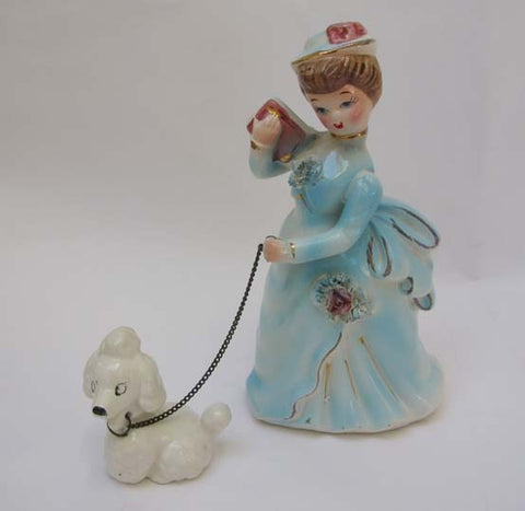 Lady and poodle figurine