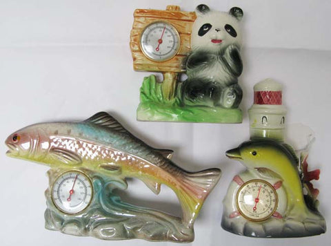 Three kitsch vintage thermometers.