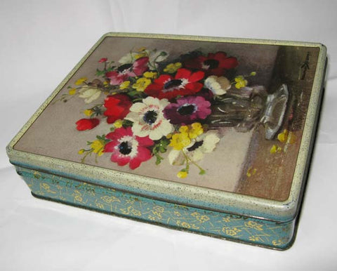 Toffee Tin with flower motif.