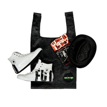 Load image into Gallery viewer, upcycled urban shopper - good bag habit big black styled with black hat + white sneakers. sustainable bag brand. made in south africa.