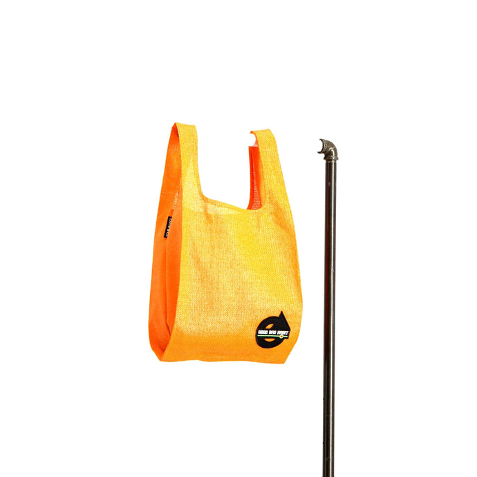 upcycled urban shopper - good bag habit standard orange. sustainable bag brand. made in south africa.