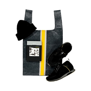 upcycled urban shopper - charcoal racer big styled with black shoes + black hat. sustainable bag brand. made in south africa.