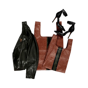 upcycled urban shoppers in rust styled with black leather jacket and black heels. sustainable bag brand. made in south africa.