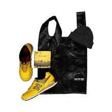 Load image into Gallery viewer, upcycled urban shopper - good bag habit big black bag styled with yellow sneakers + beanie.  sustainable bag brand.  made in south africa.