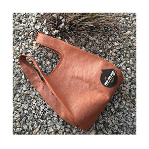 upcycled urban shopper - good bag habit standard rust on stones. sustainable bag brand. made in south africa.