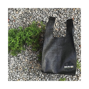 upcycled urban shopper - good bag habit black bag on stones.  sustainable bag brand.  made in south africa.