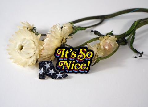 """It's So Nice!"" enamel pin pack."