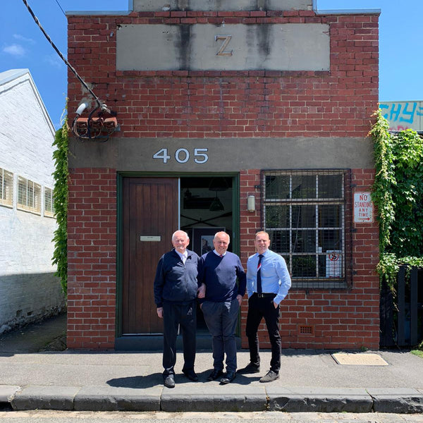 Three generations of the Linzner family return to the site of the original 1970s factory in Fitzroy, Melbourne