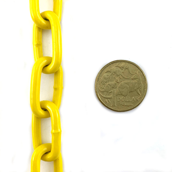 Yellow powder coated welded steel chain, size 4mm in a 25kg bucket. Melbourne, Australia.