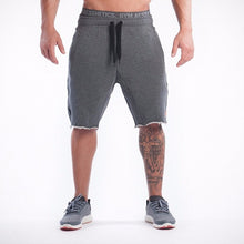 2017 men's summer Bodybuilding fitness loose board shorts men gyms stretch breathable casual Cotton shorts