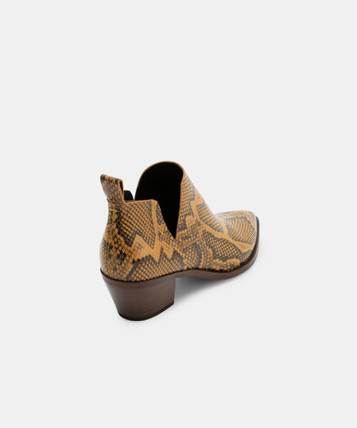 SONNI BOOTIES IN AMBER SNAKE -   Dolce Vita
