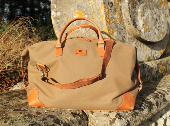 The Grantham. A classic canvas and leather holdall by Burghley Bags.