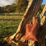 The Casterton. A classic brown leather tote bag with a vintage look by Burghley Bags. Handmade from eco-friendly vegetable tanned leather, with a shoulder strap.