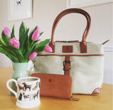 The Sedgebrook Handbag.  A classic and timeless bag by Burghley Bags.  Handmade from strong cotton canvas and leather. With strong leather handles it can be used as a shoulderbag. Shown in elegant cream.