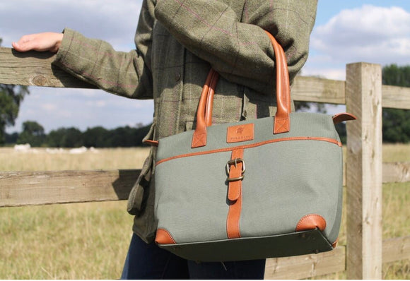 The Sedgebrook Handbag.  A classic and timeless bag by Burghley Bags.  Handmade from strong cotton canvas and leather. With strong leather handles it can be used as a shoulderbag. Shown in soft green.