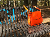 The Aunby Saddlebag.  A handmade leather bag by Burghley Bags in a vibrant burnt orange colour.