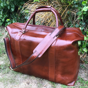 The Alford. A handmade leather holdall by Burghley Bags.  A larger than average size in a luxurious deep chestnut colour. Comes with an adjustable and detachable shoulder strap.