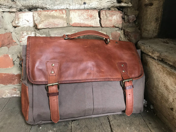 The Barholm. A contemporary handmade handmade leather and canvas briefcase by Burghley Bags. Canvas in soft grey with classic brown eco-friendly vegetable tanned leather.