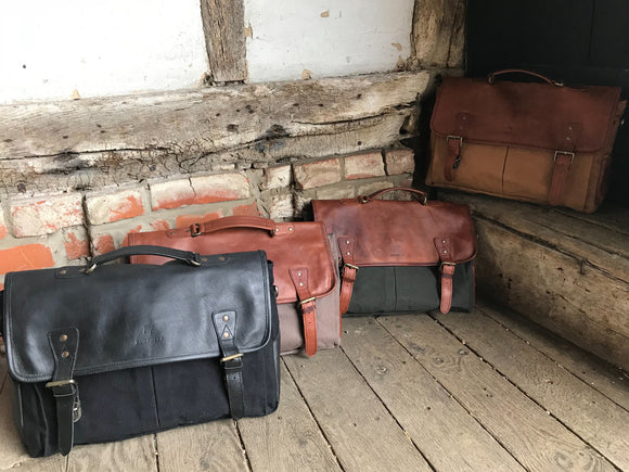 The Barholm. A contemporary handmade leather and canvas briefcase by Burghley Bags.  Made from eco-friendly vegetable tanned leather and comes with an adjustable and detachable shoulder strap. Available in 4 colours.